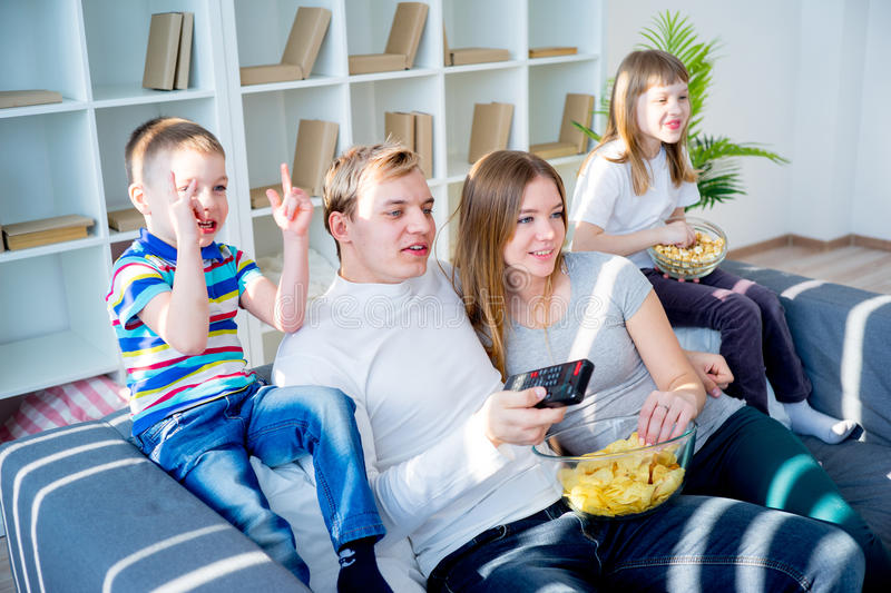 Family watching a film stock images