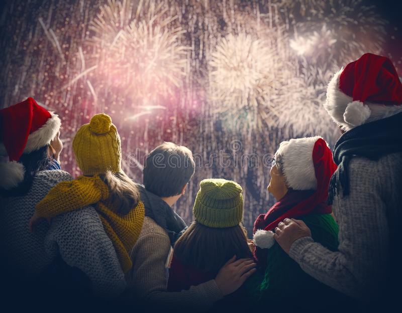 Family watching fireworks royalty free stock image