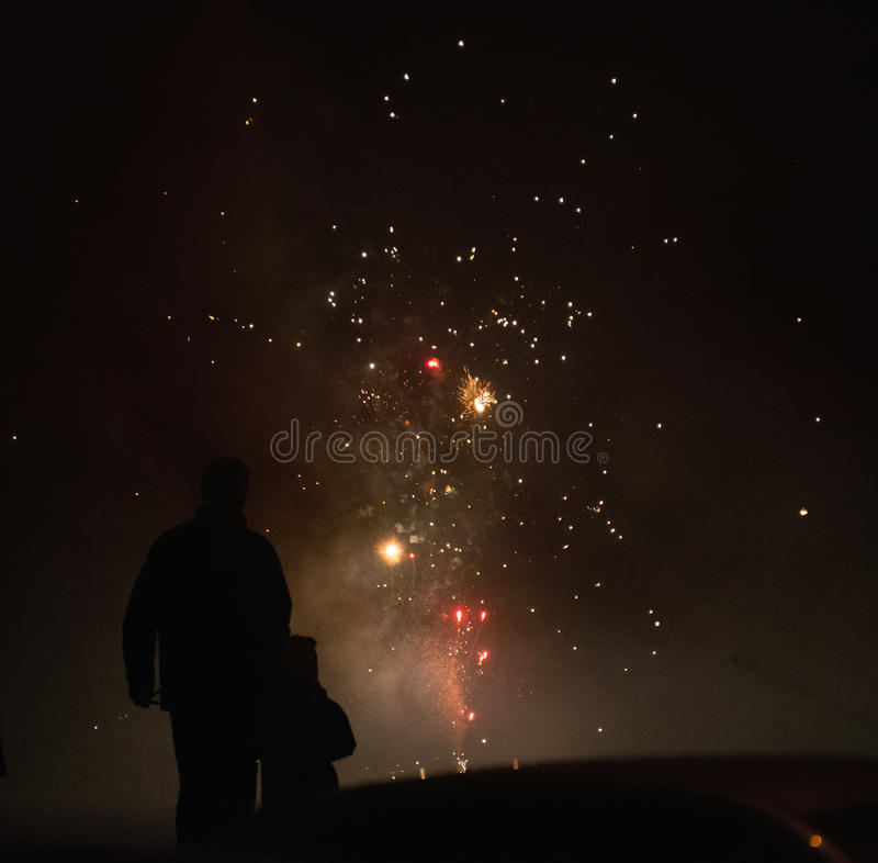 Family watching fireworks show. royalty free stock photos