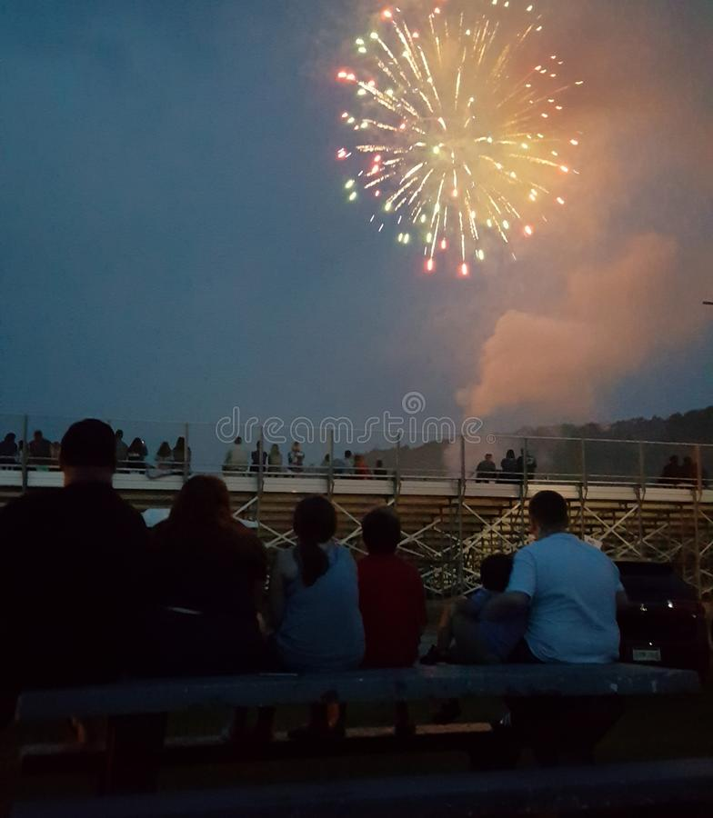 Family watching fireworks royalty free stock photography