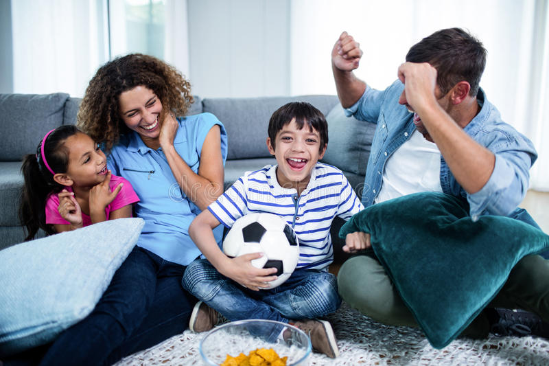 Family watching match together on television royalty free stock photography