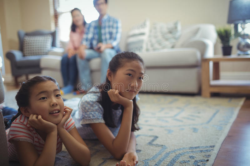Family watching television together in living room royalty free stock photography