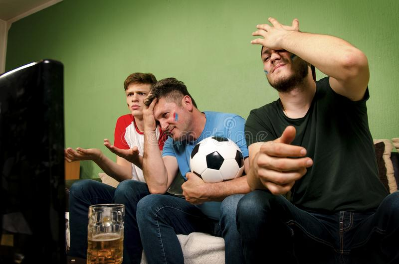 Family watching their team loss on television royalty free stock photos