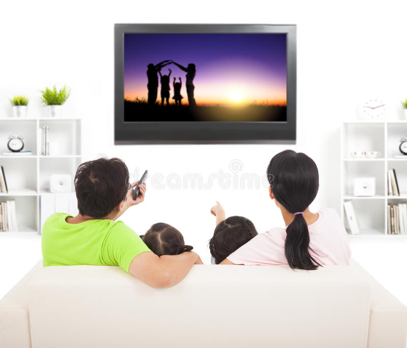 Family watching the tv. In living room