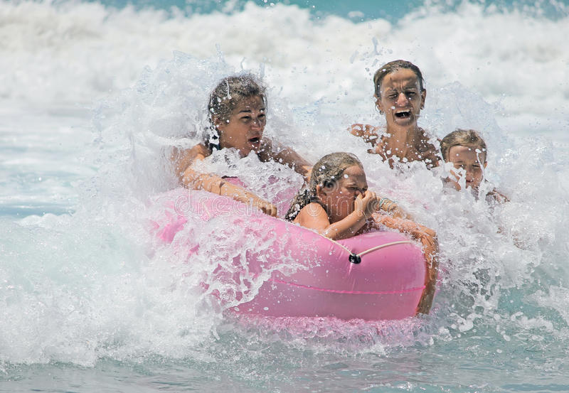 Family in the waves royalty free stock photo