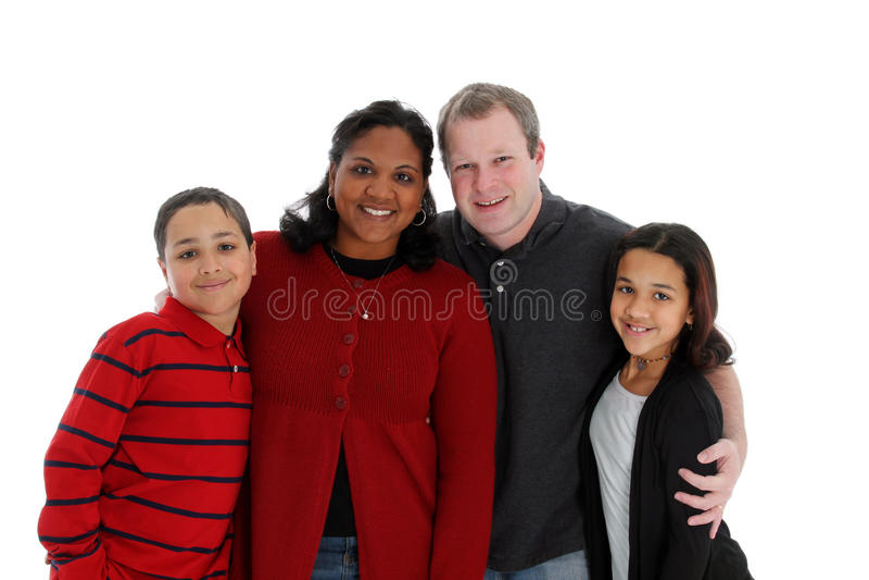 Family WB. Family of four posing on white background