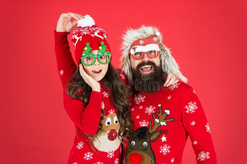 Family wear winter sweaters. Having fun. Christmas memories. Family holiday. Family values. Dad and daughter celebrate royalty free stock image