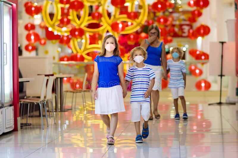 Family wearing face mask in shopping mall in Asia stock photos