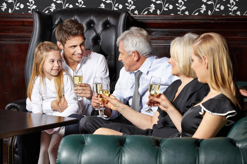 Family at wedding reception. Happy family at wedding reception drinking glass of sparkling wine royalty free stock photography