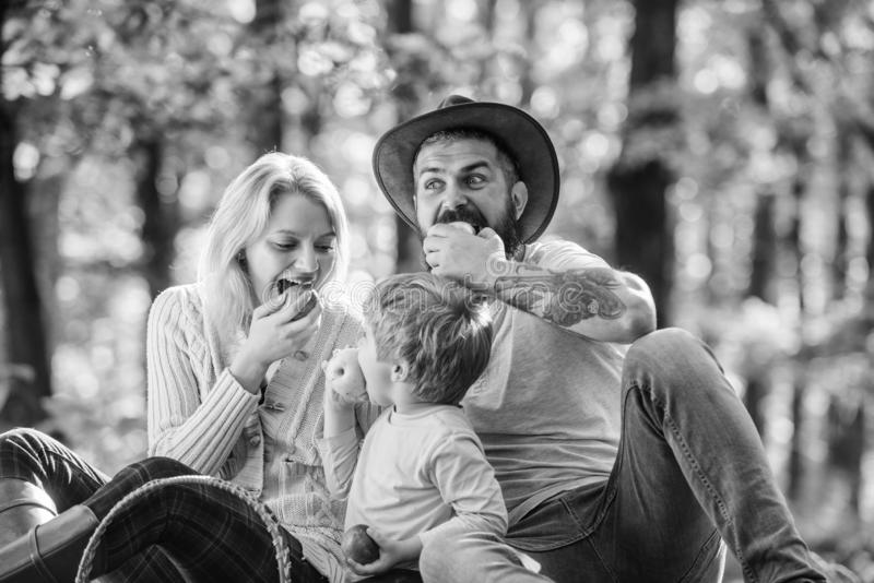 Family weekend. Mother father and little son sit forest picnic. Good day for spring picnic in nature. United with nature. Family day concept. Happy family with royalty free stock images