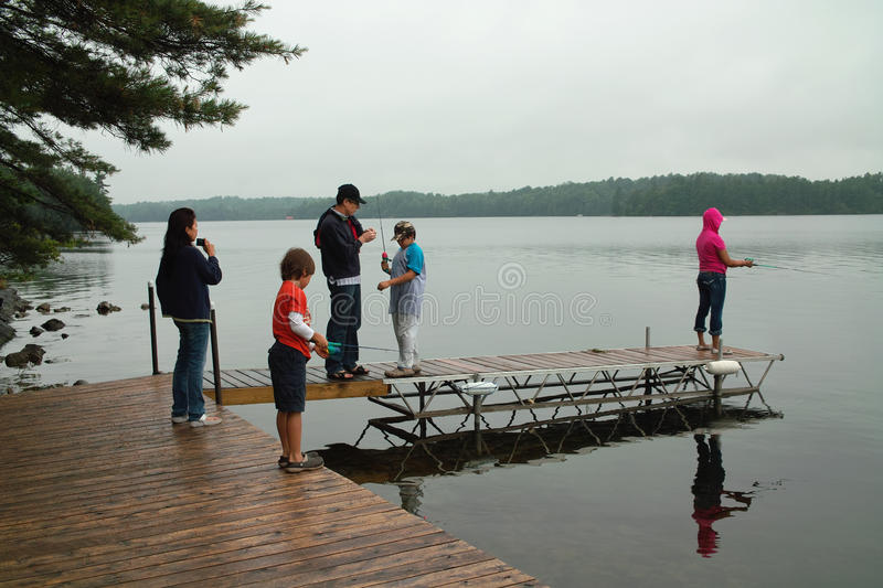Download Family Weekend At Ontario Canada Cottage Fishing. Stock Photo - Image: 20516398