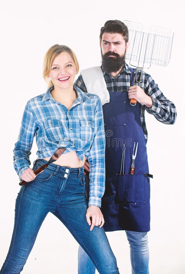 Family weekend. Sharing good time. Picnic barbecue. food cooking recipe. Tools for roasting meat. Couple in love hold. Kitchen utensils. Man bearded hipster and stock photos