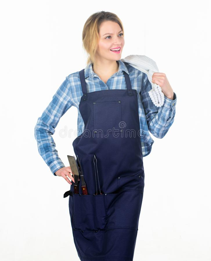 Family weekend. Woman hold kitchen utensils. Pretty girl in chef apron. Preparation and culinary. Tools for roasting. Meat outdoor. Picnic barbecue. food royalty free stock photo