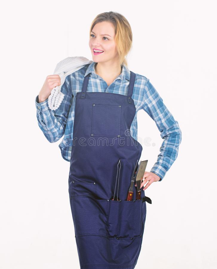 Family weekend. Woman hold kitchen utensils. Pretty girl in chef apron. Preparation and culinary. Tools for roasting. Meat outdoor. Picnic barbecue. food stock photography