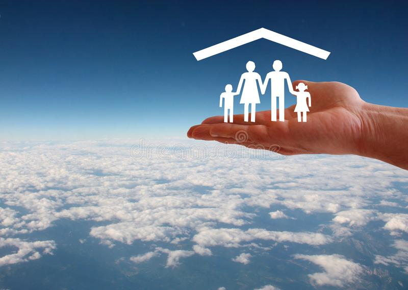 Family welfare concept with hand and roof on aerial sky view background stock photos