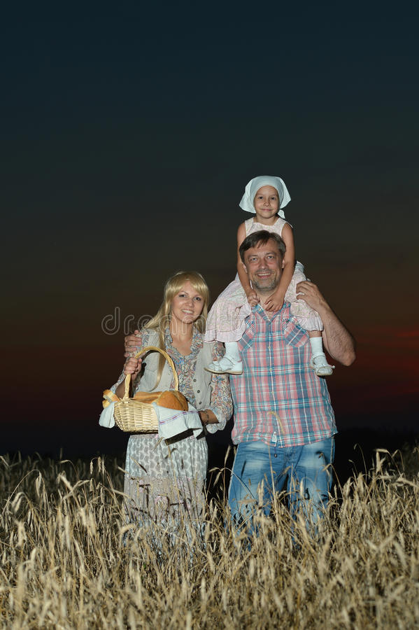 Family on wheat field royalty free stock photography