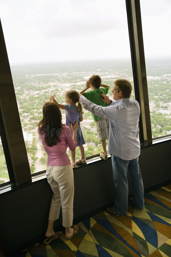 Family at window. royalty free stock image