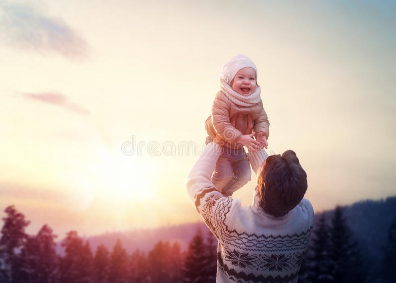 Family and winter season. Happy loving family! Father and his daughter are playing and hugging outdoors. Cute little girl and daddy on snowy winter walk in stock image
