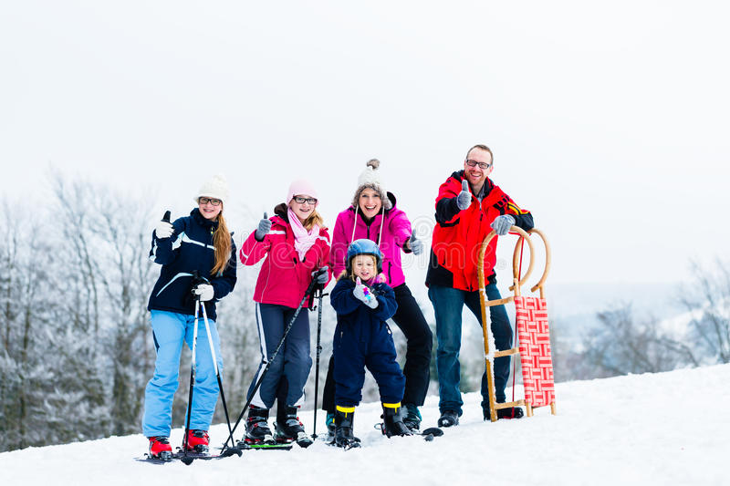 Family in winter vacation doing sport outdoors. Family on vacation doing winter sports outdoors stock photos