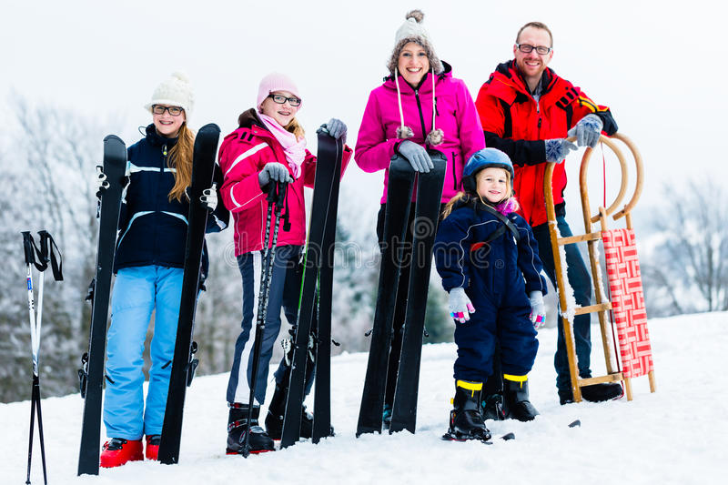 Family in winter vacation doing sport outdoors. Family on vacation doing winter sports outdoors royalty free stock image