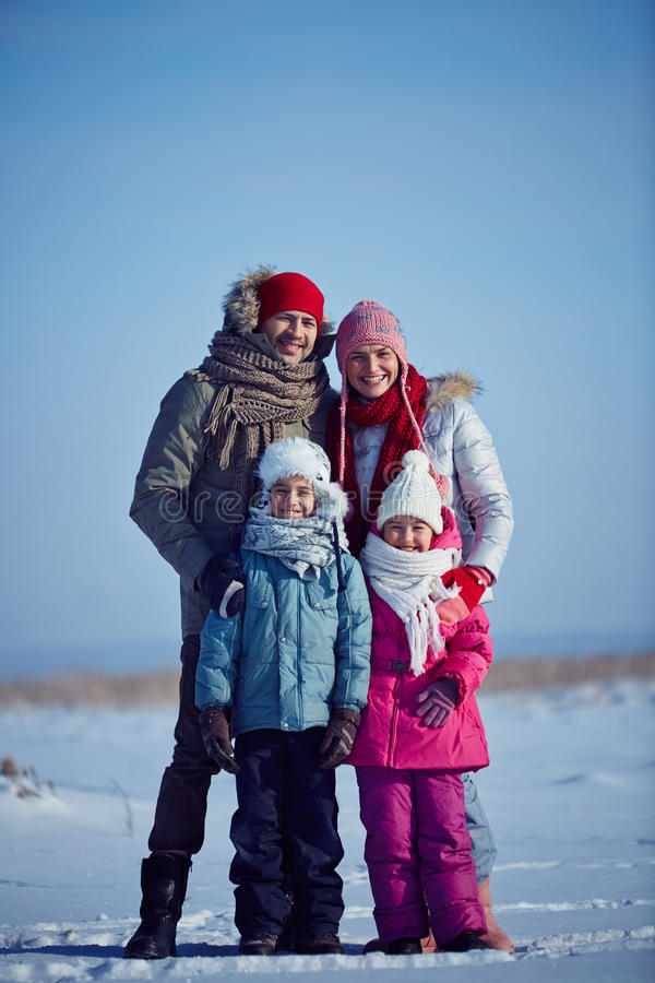 Family in winterwear. Happy parents and their kids in winterwear royalty free stock photography