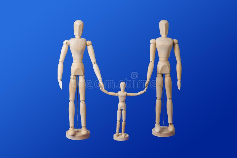 Family - wooden toy figures on blue royalty free stock image