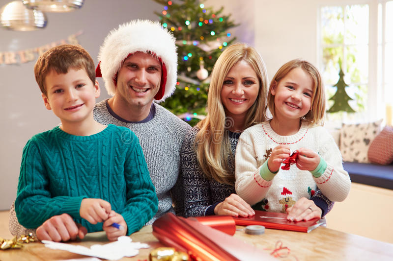 Family Wrapping Christmas Gifts At Home royalty free stock photography