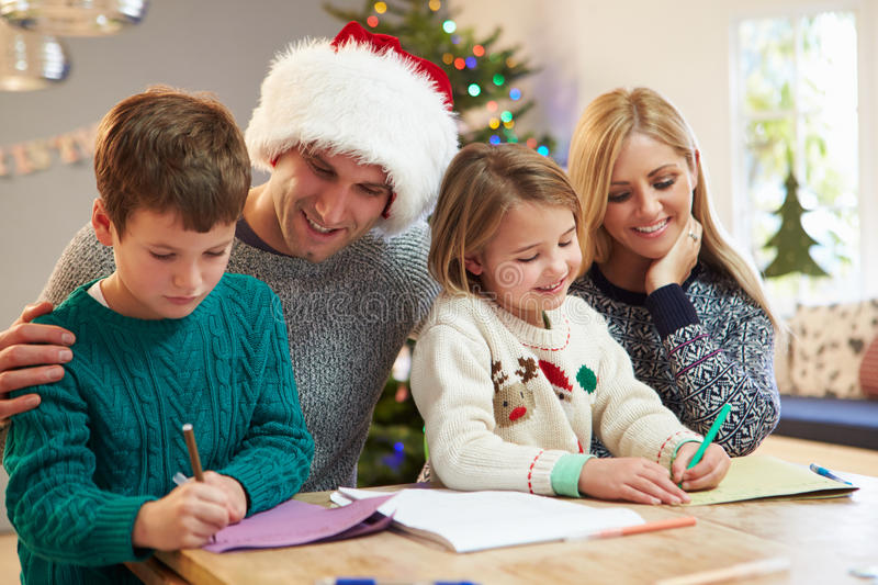Family Writing Christmas Cards Together stock images