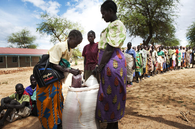 Famine. A team of local people are running the foodstation in Krisrooa, Kenya. People are standing in line to get their rations