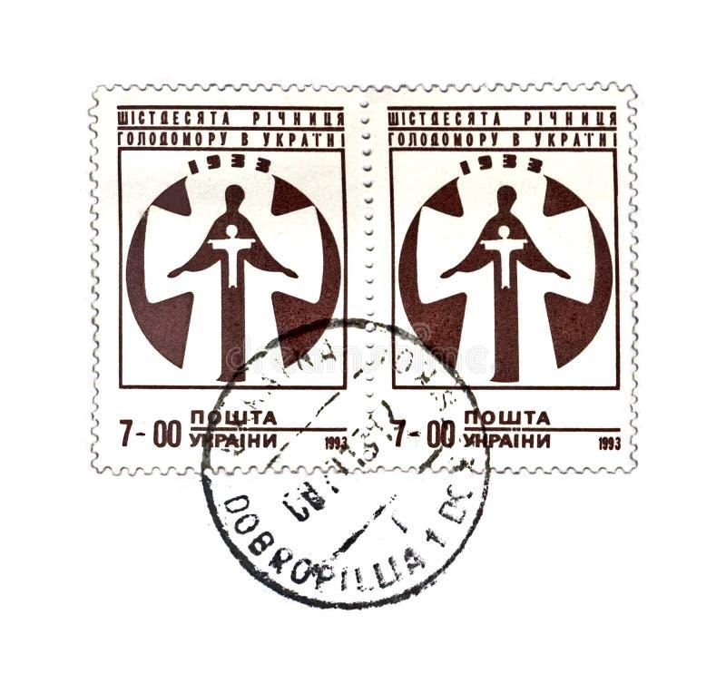 Famine of 1932-33 in Ukraine, circa 1993,. KIEV, UKRAINE - CIRCA 1993: canceled stamp printed in Ukraine shows famine of 1932-33 in Ukraine, circa 1993. vintage royalty free stock image