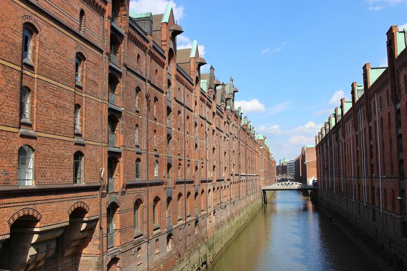 "The famous ""Speicherstadt"" in Hamburg, Germany, Europe. Old storehouses and canal in late afternoon royalty free stock photos"