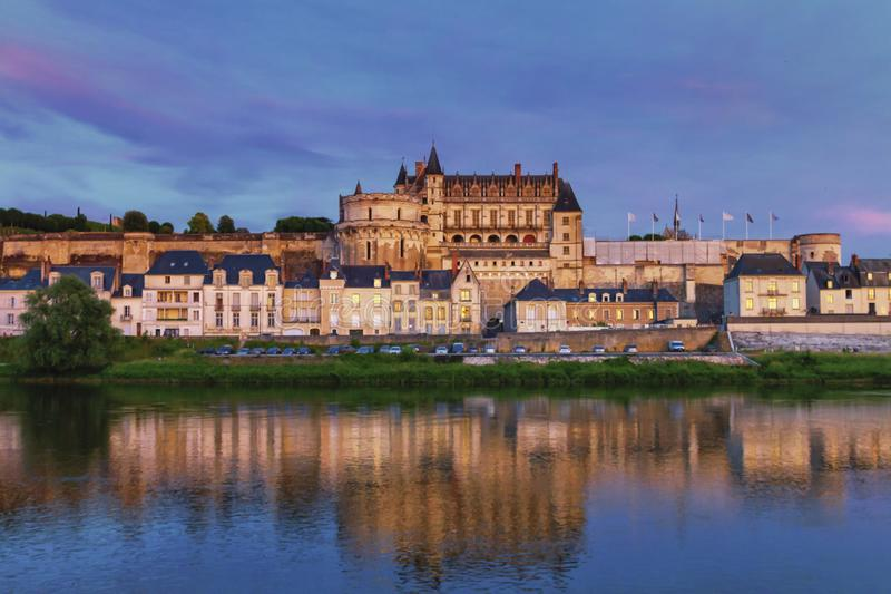 Famous Amboise Castle over Loire river, France. Famous Amboise Castle and reflexion over Loire river by night, France stock photo