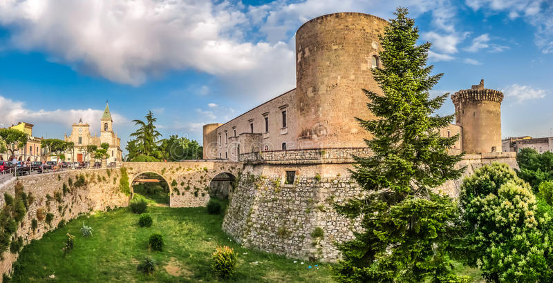 Famous Aragonese Castle (Castello Aragonese) in Venosa, Basilicata, Italy. Panoramic view of the historic town of Venosa with famous Aragonese Castle (Castello royalty free stock photos
