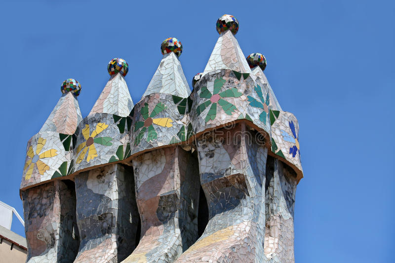 The famous architect Gaudì ­ treated rooftop chimneys like pieces of art on the rooftop of the house Casa Batllo on Barcelona royalty free stock images