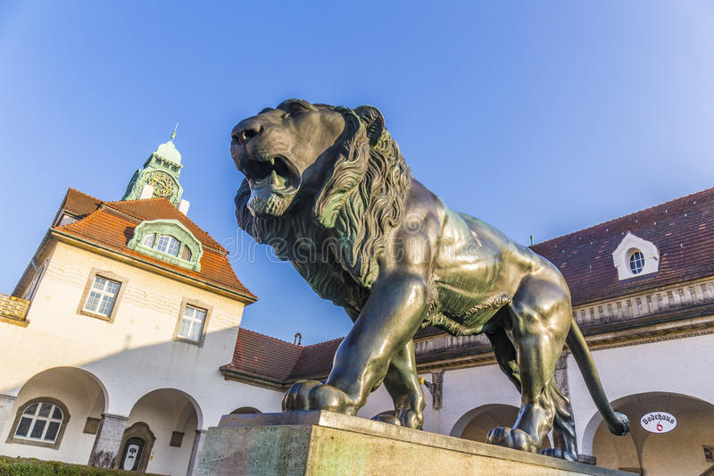 Famous art nouveau lion statue at Sprudelhof in Bad Nauheim. Under blue sky royalty free stock photography