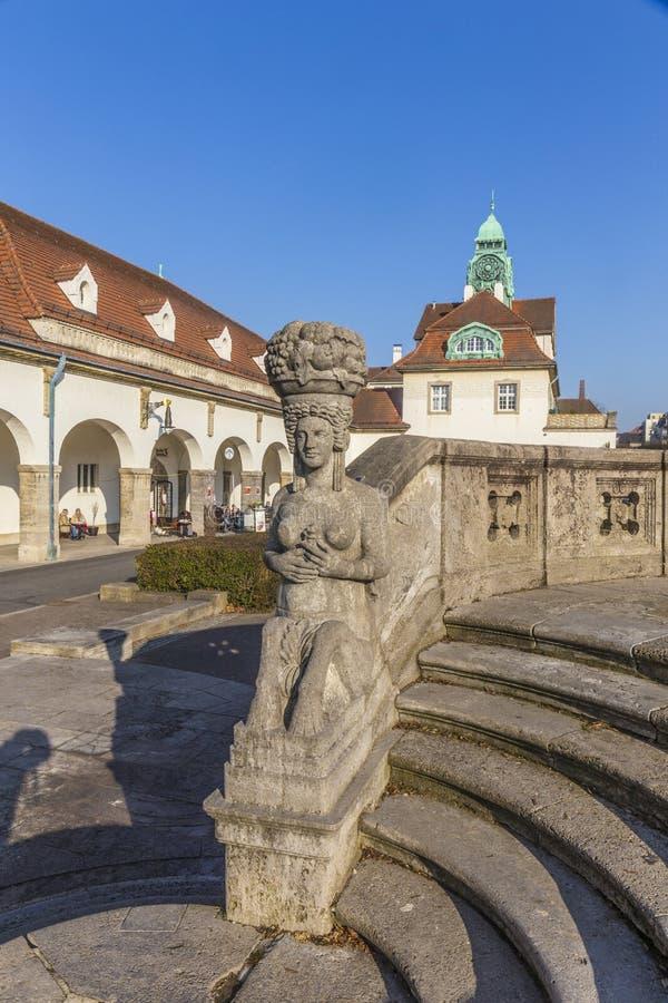 Famous art nouveau statue at Sprudelhof in Bad Nauheim. Under blue sky stock images