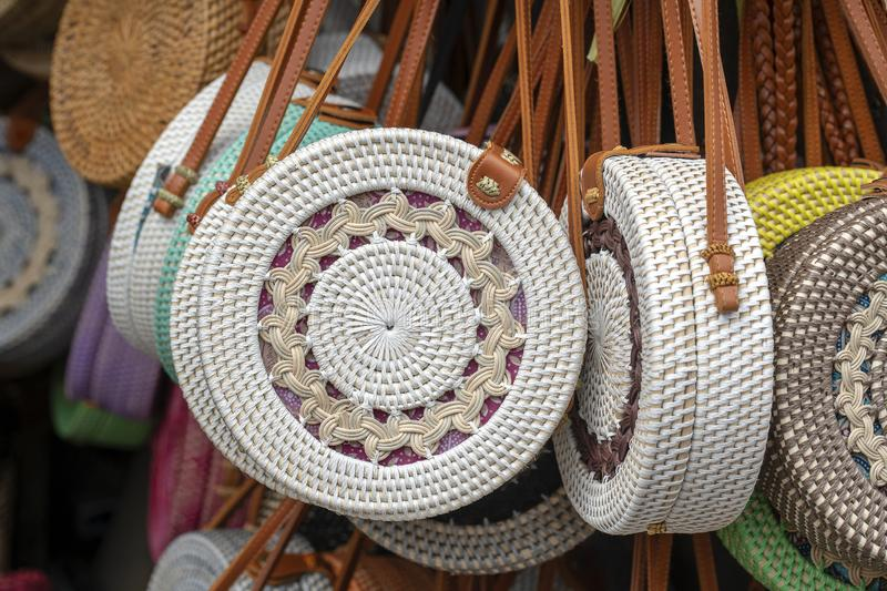 Famous Balinese rattan eco bags in a local souvenir market on street in Ubud, Bali, Indonesia. Handicrafts and souvenir shop stock image