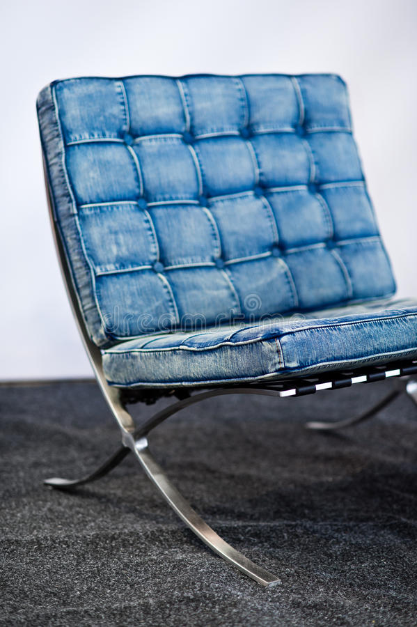 Famous Barcelona chair in blue jeans color royalty free stock photo