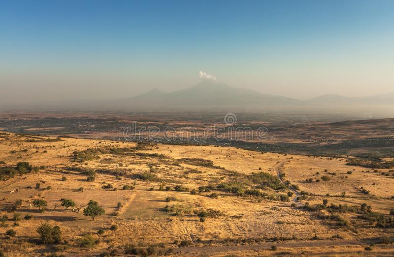 Famous Biblical Mountain of Ararat and vast fields. Landscape of Biblical mountain of Ararat in Armenia, Caucasus at the background and large farming fields stock photography