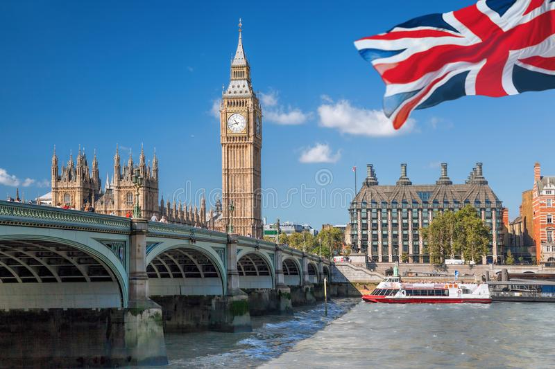Big Ben and Houses of Parliament with boat in London, England, UK royalty free stock image