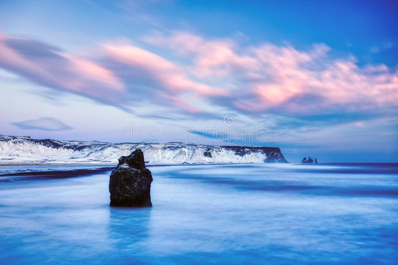 Famous Black Sand Beach, Dyrholaey Cliffs and he Mount-Reynisfjall near Vik in Winter, Iceland. Famous Black Sand Beach, Dyrholaey Cliffs and he Mount stock photography