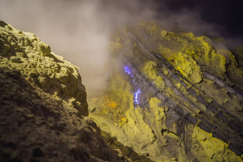 Famous the Blue fire inside the crater of the Ijen volcano on Java Island, Indonesia, where miners collect sulfur that royalty free stock photos