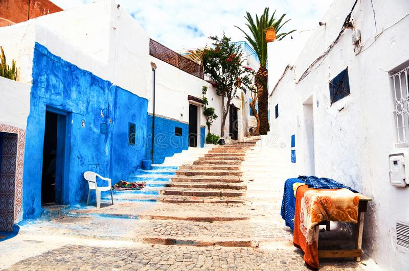 Famous blue and white streets of Kasbah of the Udayas in Rabat. Rabat, Morocco. Famous blue and white streets of Kasbah of the Udayas in Rabat. The capital of stock photo