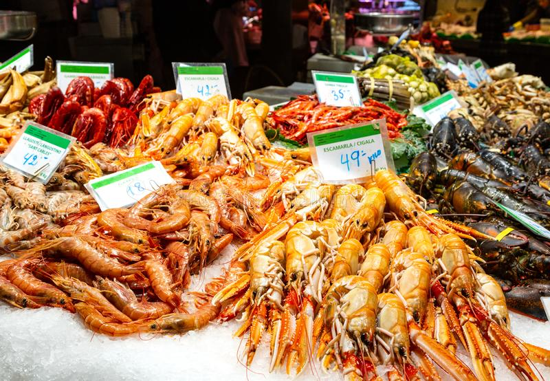 Famous Boqueria food market. Barcelona, Spain December 15, 2018: seafood at marketplace, famous Boqueria food market stock images