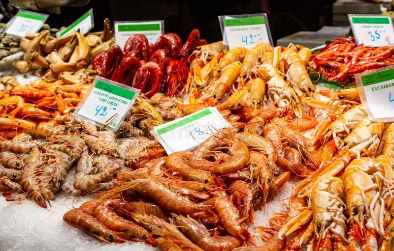Famous Boqueria food market. Barcelona, Spain December 15, 2018: seafood at marketplace, famous Boqueria food market royalty free stock photos