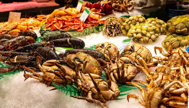 Famous Boqueria food market. Barcelona, Spain December 15, 2018: seafood at marketplace, famous Boqueria food market stock photos