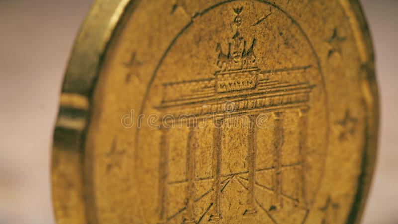 Famous Brandenburg Gate in Berlin on German 20 Euro cents coin, macro shot stock photography