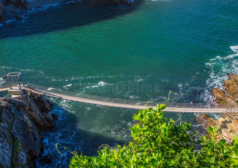 Famous bridge over Storms River Mouth at the Indian Ocean stock image