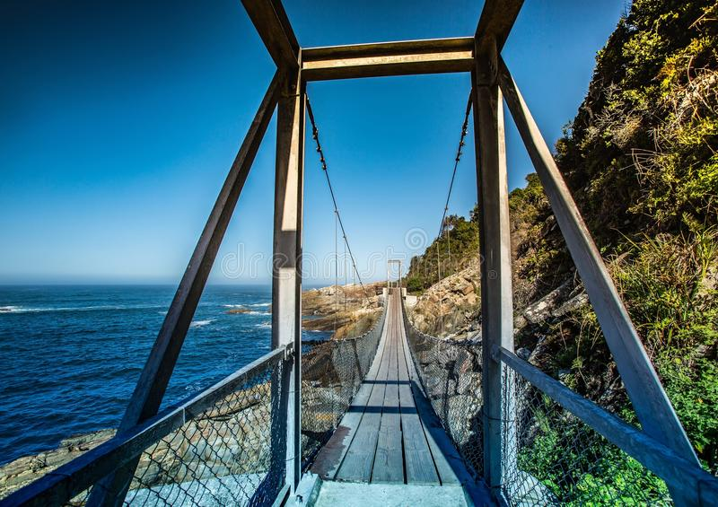 Famous bridge over Storms River Mouth at the Indian Ocean stock images