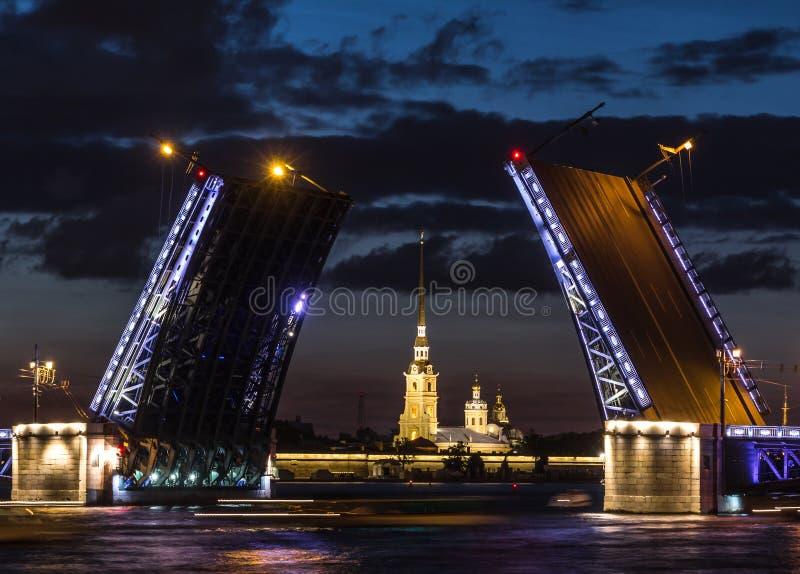 The famous drawbridges of St. Petersburg. The Famous Bridges Of St. Petersburg. Drawbridge. Night city. City on Neva river. Palace bridge. Palace embankment royalty free stock images